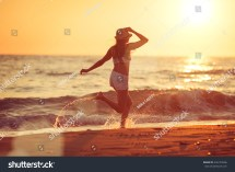 Young Beautiful Woman Running Barefoot Surf Stock