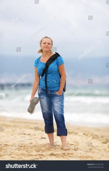 Young Blonde Woman Barefoot Blue Tshirt Stock