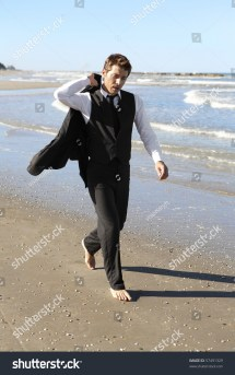 Young Businessman Walking Barefoot Beach Stock