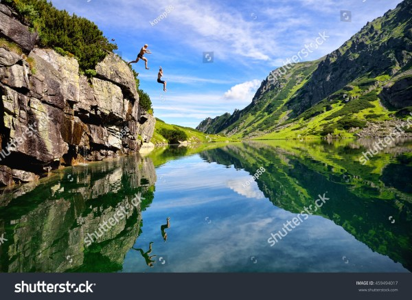 Young Couple Jump Lake Stock 459494017 - Shutterstock