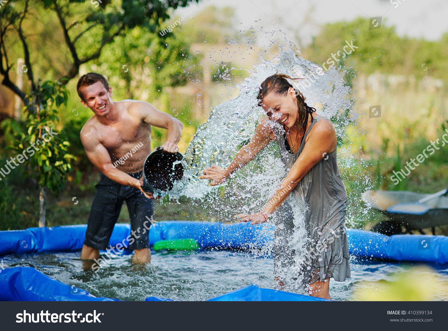 Young Couple Pours Water Fun Summer Stock Photo