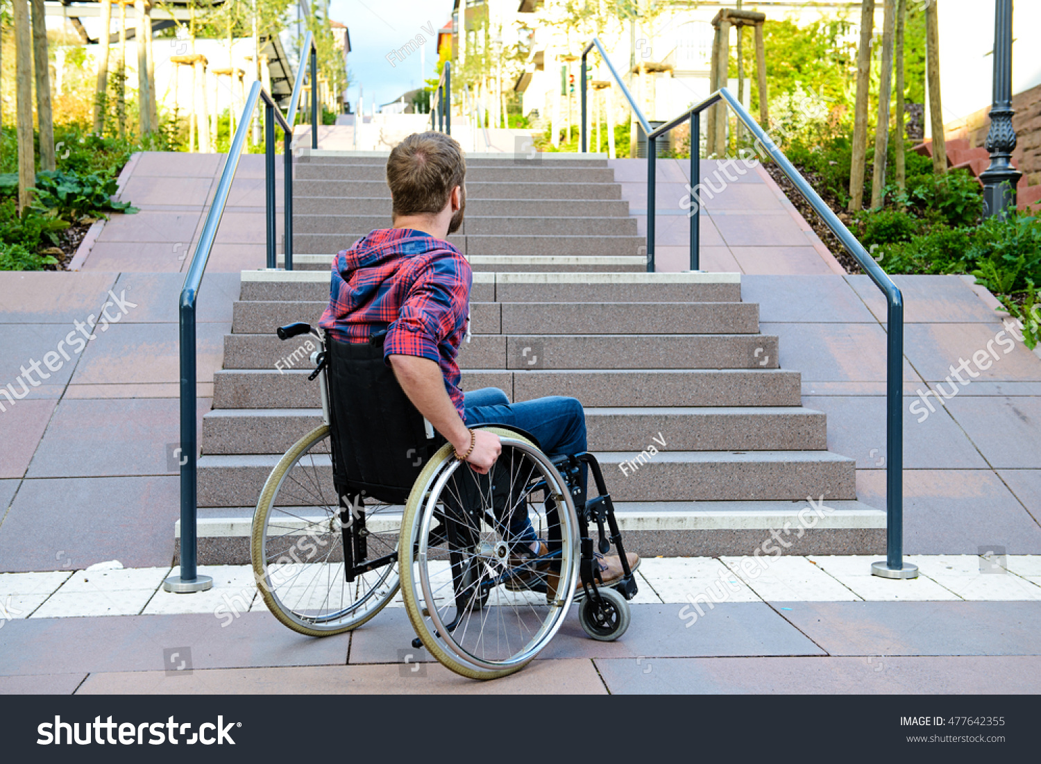 wheelchair man ergonomic chair lower back support young disabled front stairs stock photo
