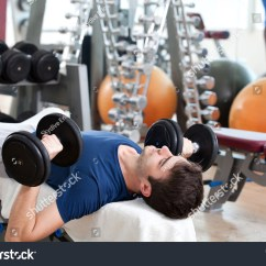Gym Chest Chair Rolling Shower With Seat Belt Young Man Training Dumbbell Stock Photo