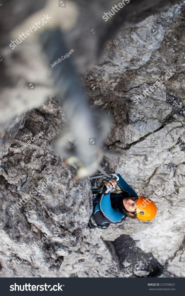 Young Woman Climbing Steep Rock Face Stock 210799021 Shutterstock