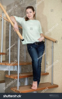 Young Woman Dressed Jeans Bare Feet Stock 389566261