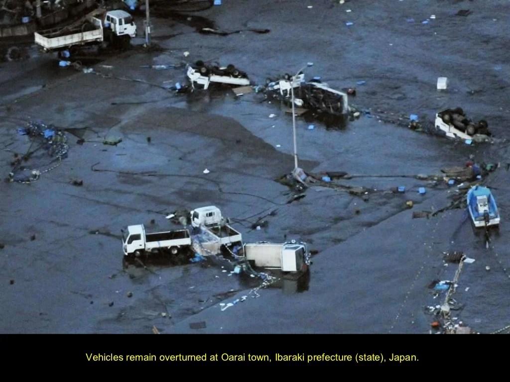 Vehicles Remain Overturned At Oarai