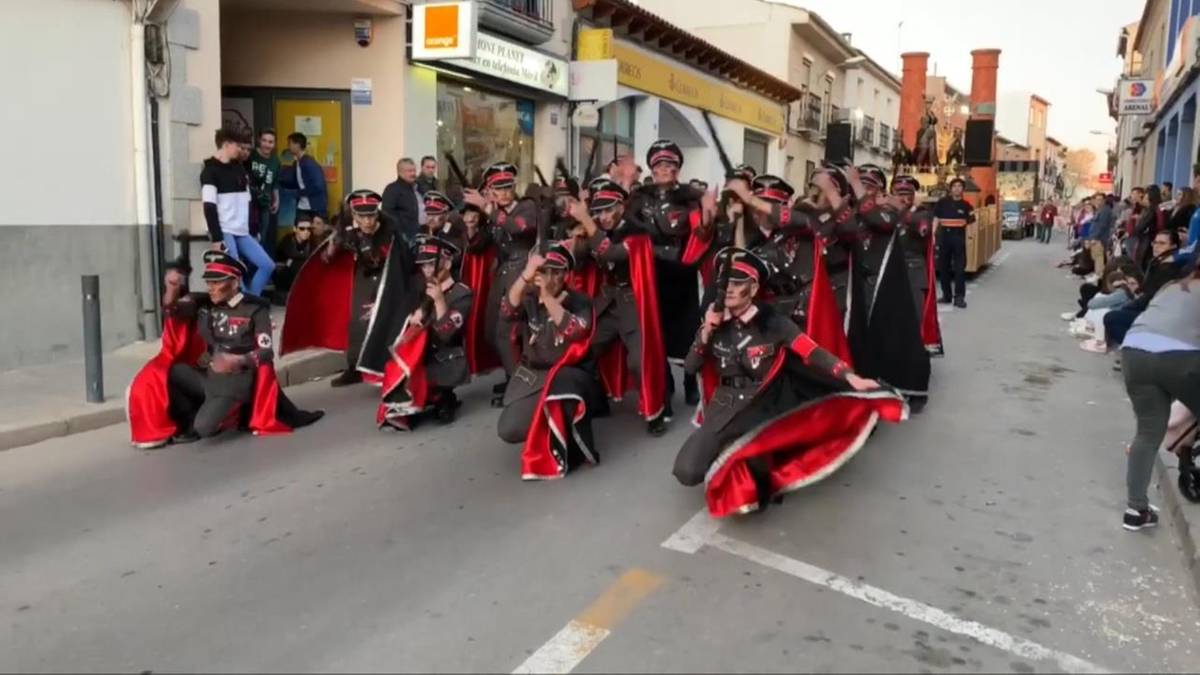 Spain: group marches as SS men and concentration camp prisoners at carnival