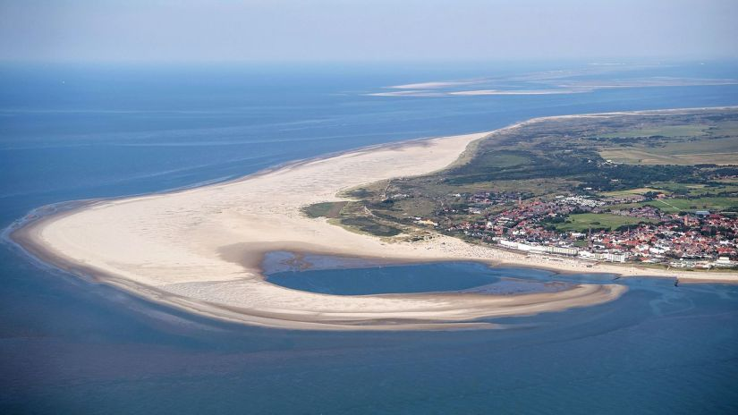 The East Frisian island of Borkum from the air.  The port is used by ferries and cruise ships.