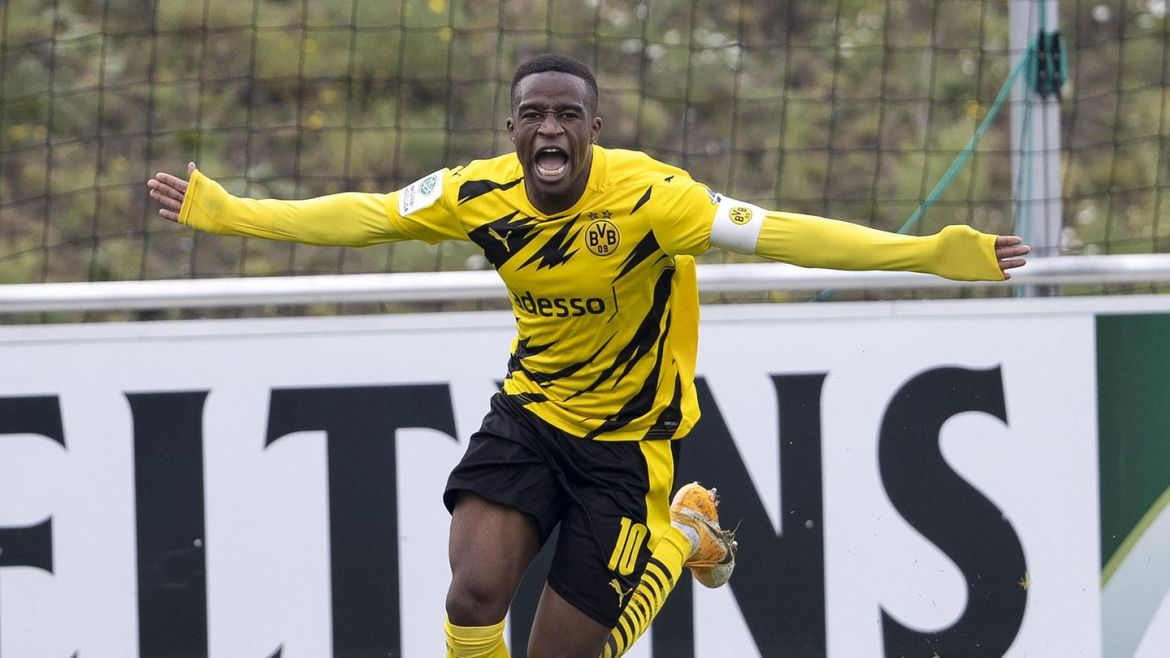 Youssoufa Moukoko cheers after his goal against Schalke 04 in the A youth derby