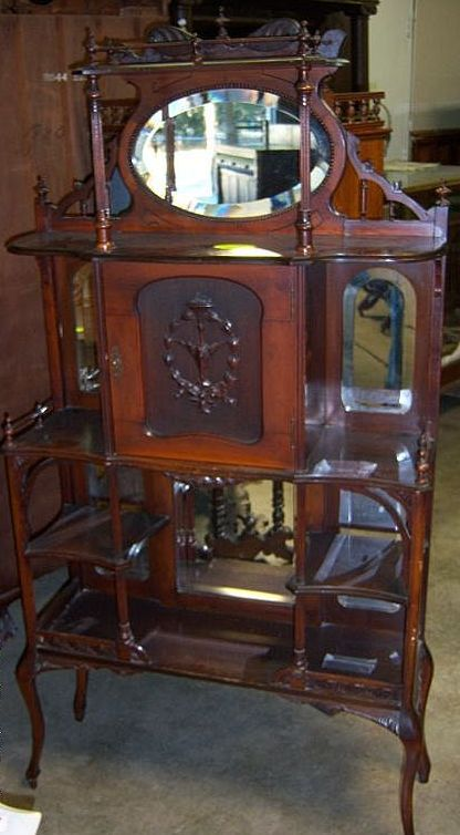 Victorian Etagere with Mirror Galleries Shelves Carved Door from robertsantiques on Ruby Lane