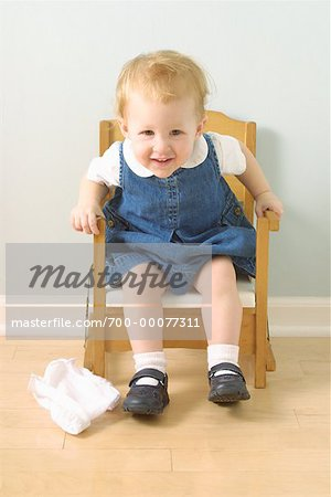 potty chair for girls covers hire roodepoort girl sitting in stock photo masterfile rights managed