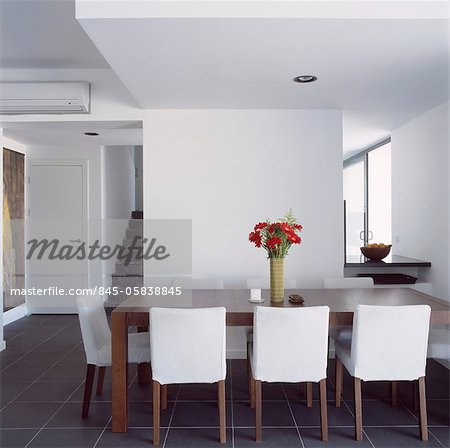 white upholstered chairs clear dining chair around wooden table in contemporary room stock photo