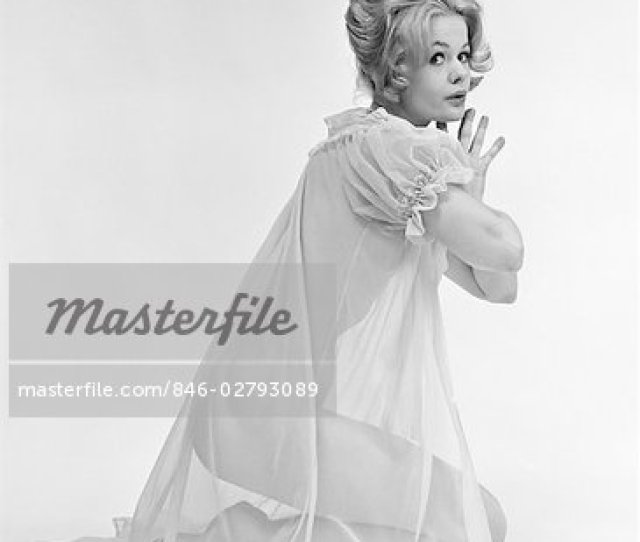 S Profile Portrait Of Blond Woman In Sheer Nightgown Kneeling Down With Hands Pressed Together Looking