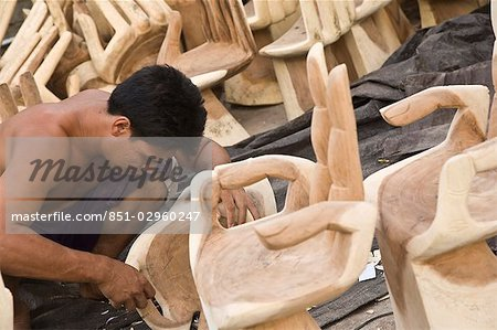 wood hand chair lane leather office brown man carving wooden chairs bali indonesia stock photo
