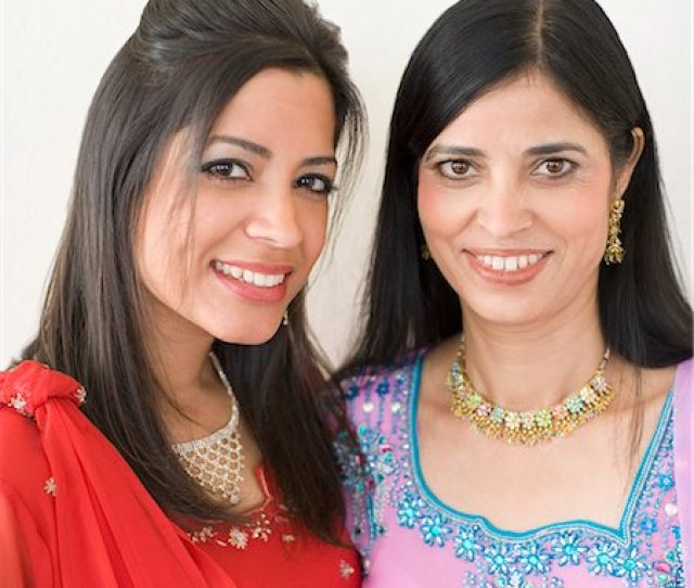 Desi Women Adult Photo Portrait Of A Mature Woman Smiling With Her Daughter Stock Photo