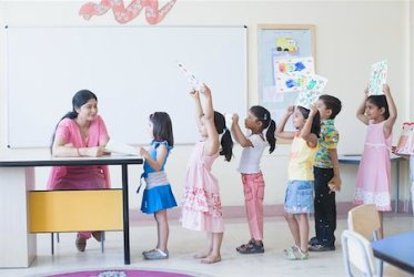 Indian teachers with young boy Stock Photos Page 1 : Masterfile