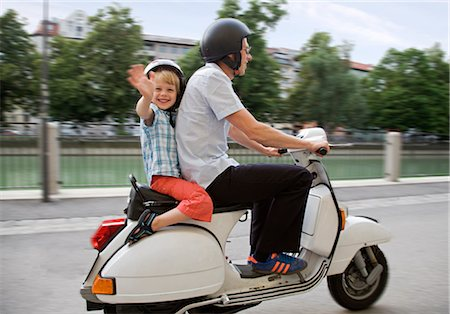 Image result for dad and son on scooter
