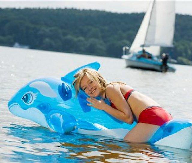 A Girl Lying On An Pool Raft On A Lake Stock Photo Premium Royalty