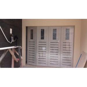 Jual Pintu garasi Model minimalis memakai lubang kaca Harga Murah Depok oleh Central Garasi