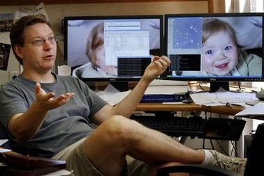 科技时代_图文:美国天文学家谈论太阳系扩大为12行星论