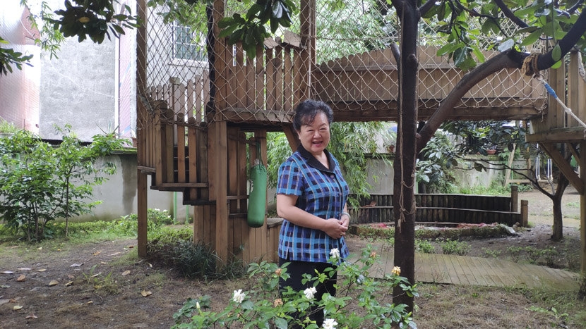 Founder Xue Mei poses for a photo in the garden of Xiyanghong, Guiyang, Guizhou province, June 17, 2019. Fan Yiying/Sixth Tone