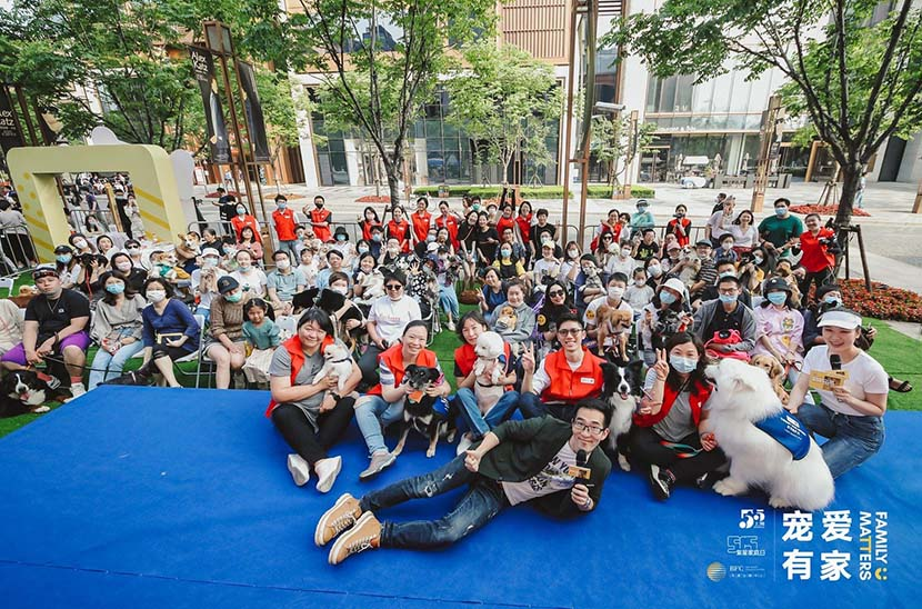 Wu Qi (front), the founder of Paw for Heal, poses for a group photo at the end of an animal-assisted therapy training course at the Bund Finance Center in Shanghai, May 17, 2020. Courtesy of the Bund Finance Center