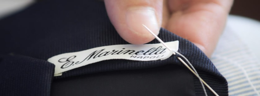 The moment a tie is finished and the E. Marinella brand tag is sewn by hand.