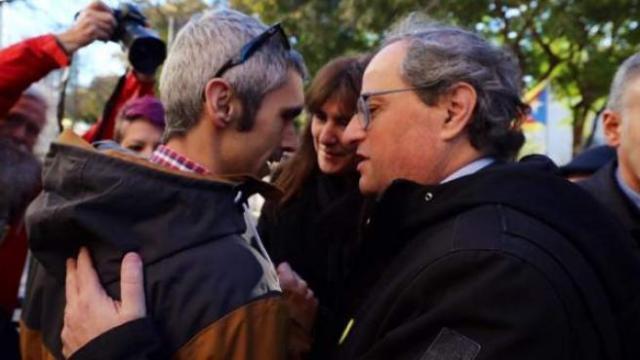 El presidente Quim Torra con Roger Español.