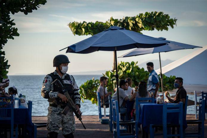 An element of the National Guard patrols the tourist boardwalk of Puerto Vallarta.