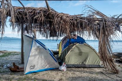 A migrant rests in one of the tents on Necoclí beach.