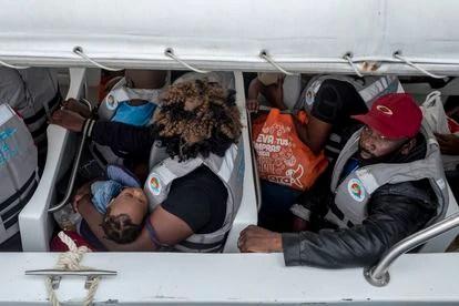 Haitian migrants embarking on the dock.