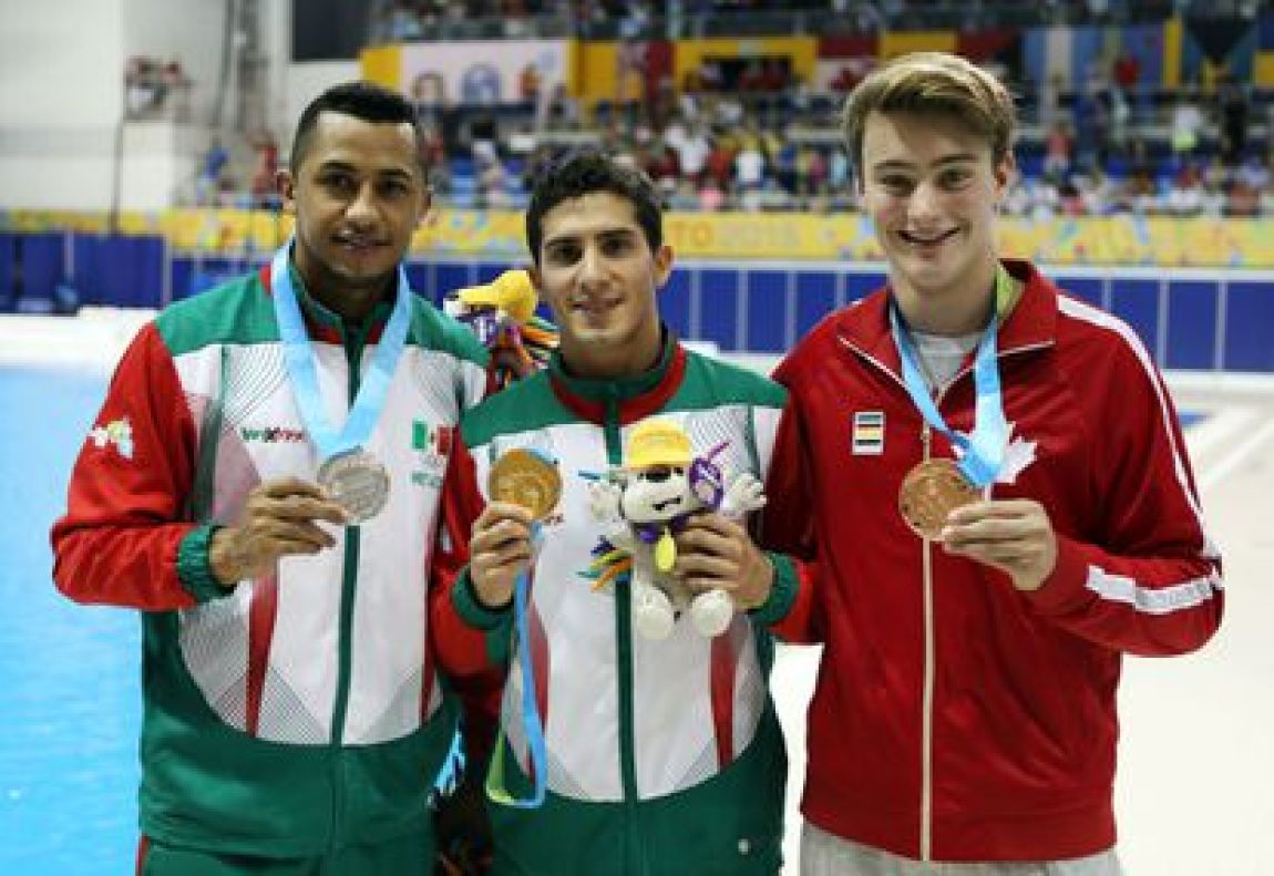Mexicans Jahir Ocampo and Rommel Pacheco with Canadian Philippe Gagne at the 2015 Pan American Games.
