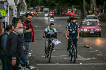 People ride bicycles in the Buenavista neighborhood of Mexico City, Mexico.