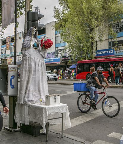 A person rides a bicycle past a shrine to Santa Muerte in the Centro Hist-rico neighborhood in Mexico City, Mexico.