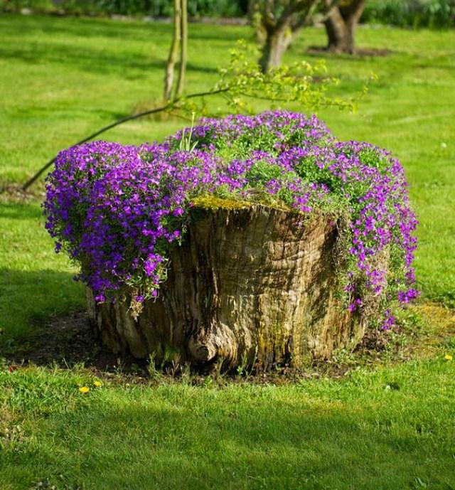 Imagenes de troncos reciclados como materas de flores