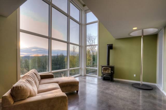 living-room Sala de estar com piso de cimento queimado