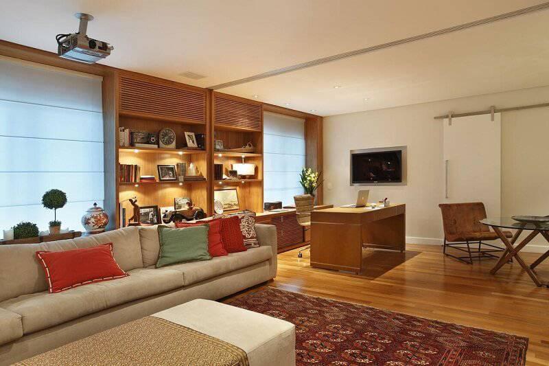 sala planejada com estante com luzes projeto de Escala Arquitetura