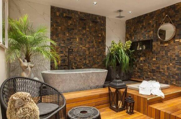 Banheiro de luxo com banheira de pedra Projeto de Casa Cor Franca 17