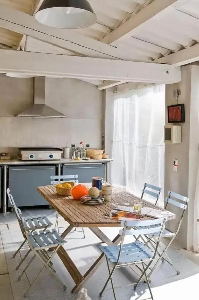 decoração simples e clean em área gourmet rústica