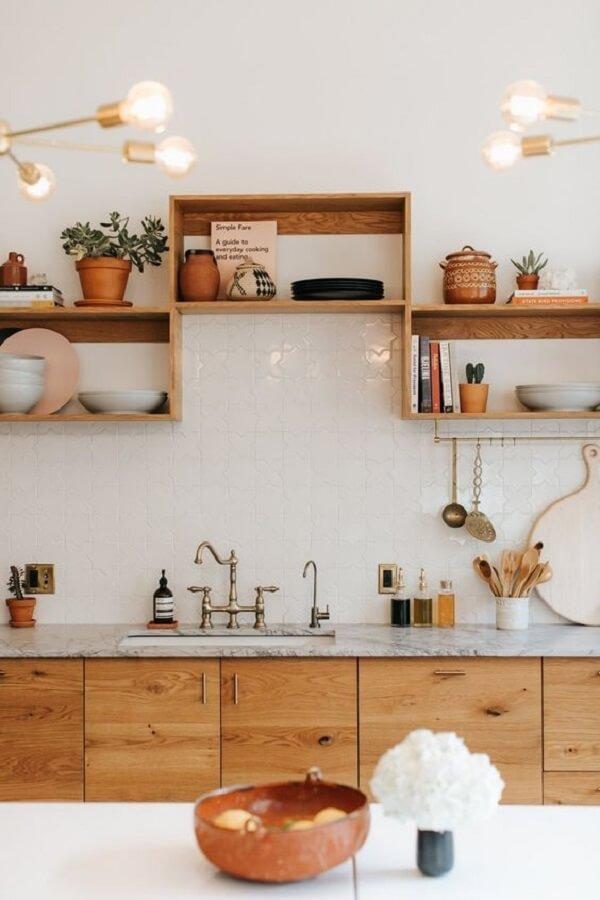 Rectangular wooden niches help organize kitchen utensils