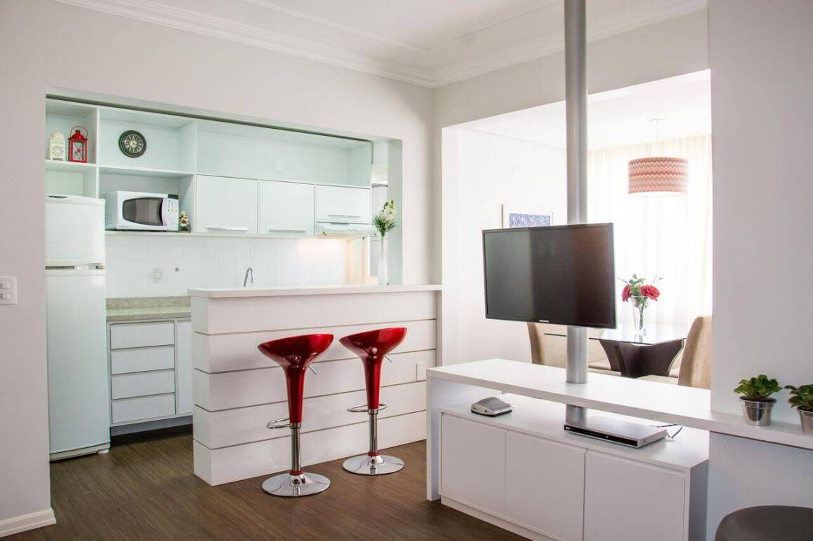 Tall red stools in clean American kitchen