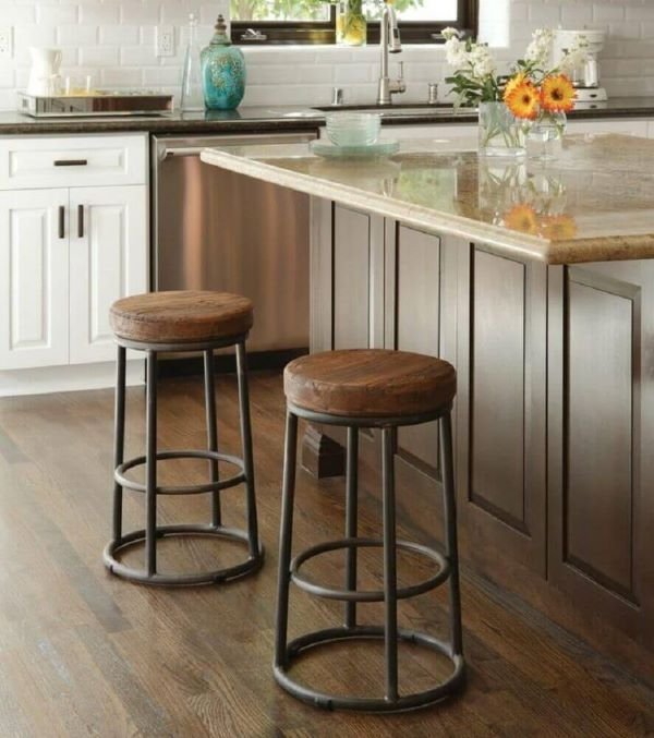 Low wooden and iron stools on kitchen island
