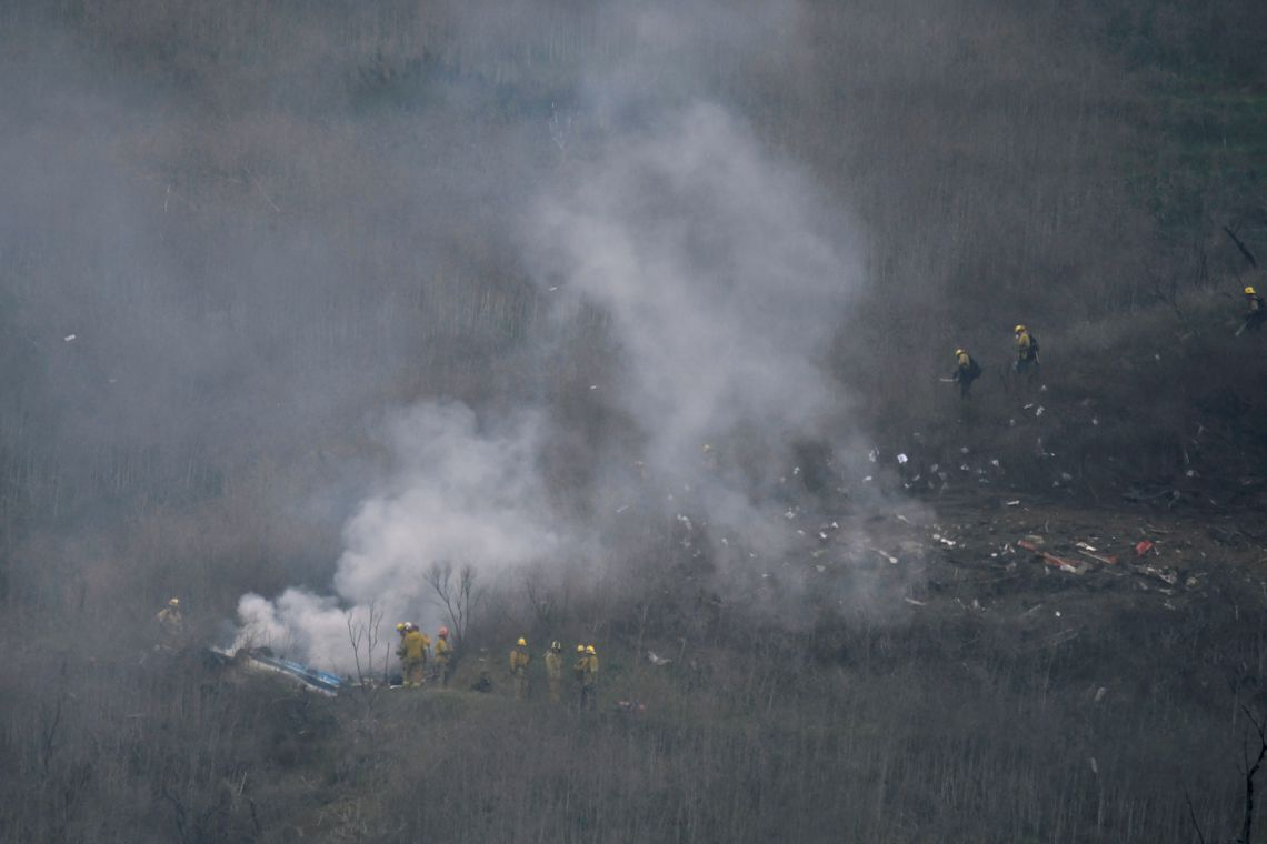 LA county firefighters on the scene of a helicopter crash that reportedly killed Kobe Bryant in Calabasas, California, U.S., January 26, 2020. REUTERS/Gene Blevins