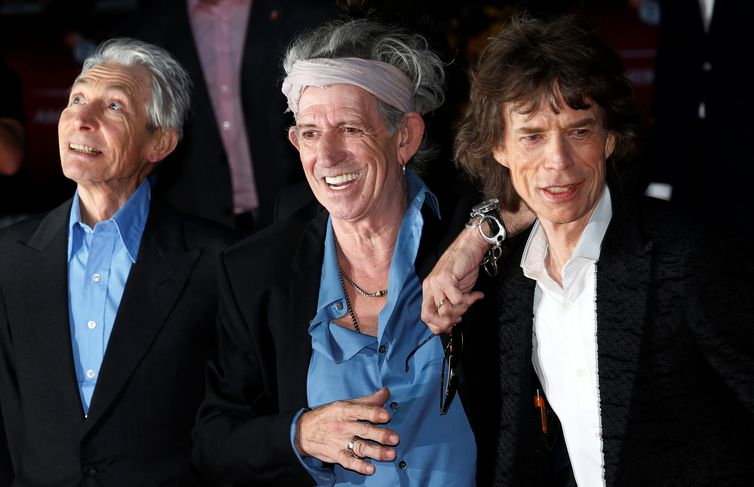 FILE PHOTO: Rolling Stones members Watts, Richards and Jagger arrive for the world premiere of