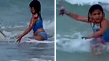 [VIDEO] Mamá graba cómo su hija escapa de un tiburón en Hawái