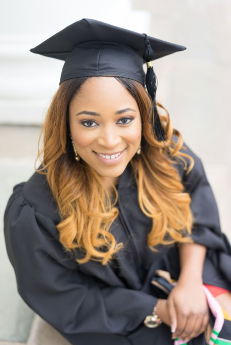 A woman poses at the University of Maryland during her graduation session.