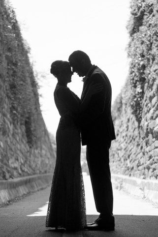 A bride and groom silhouetted in Old Town Alexandria.