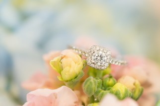 An engagement ring tucked into a bride's bouquet.