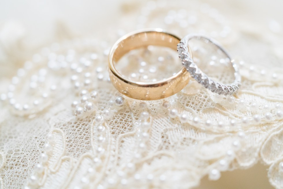 Wedding bands shown on a piece of lace.