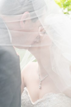 A groom and bride kiss after their Georgetown wedding.